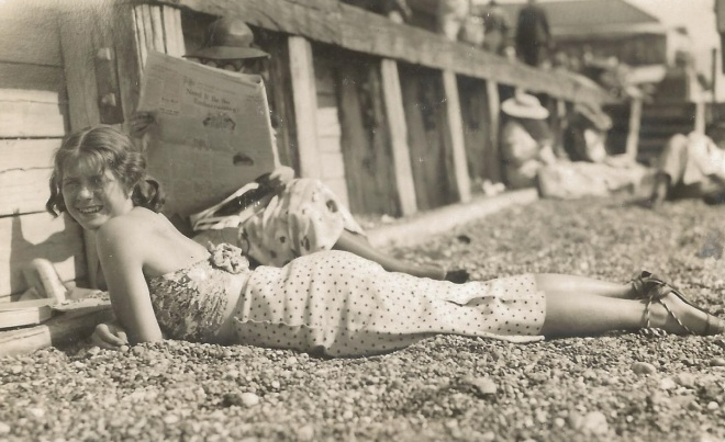 Joan enjoying the sunshine as a youngster