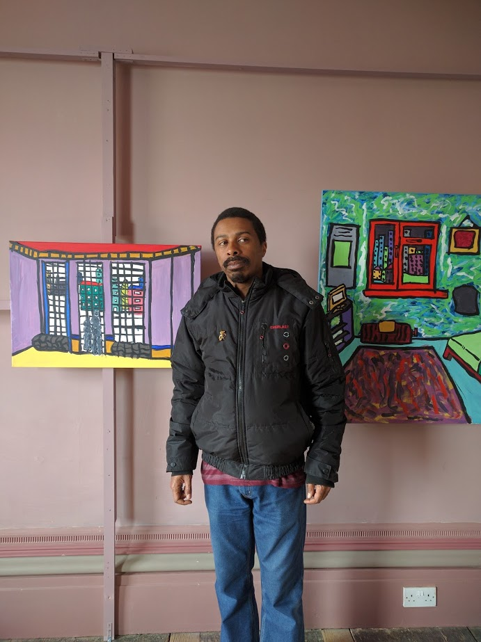Thompson Hall with two of his paintings at the Regency Town House in Brighton