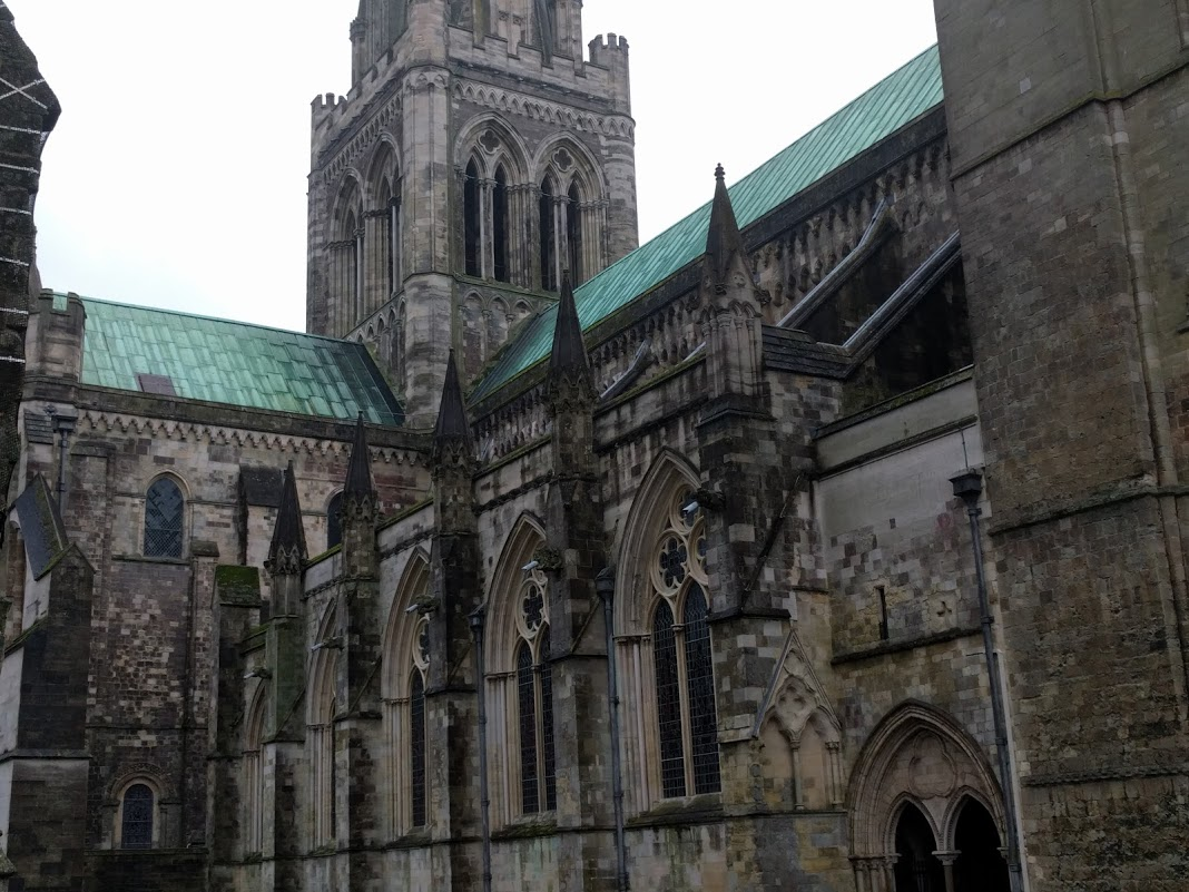 View of Chichester Cathedral behind the statue of Saint Richard