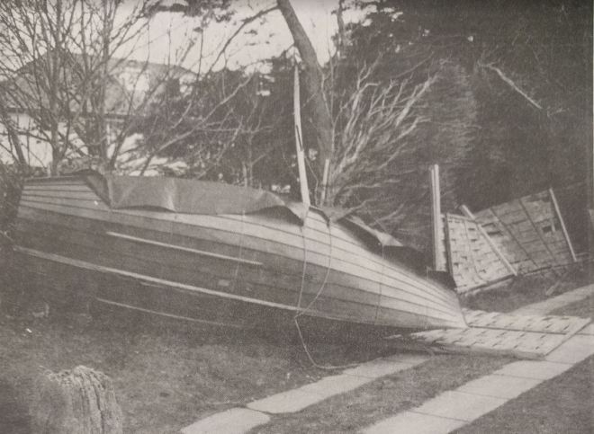 A yacht blown high and dry by the storm hit someone's garden in the Witterings