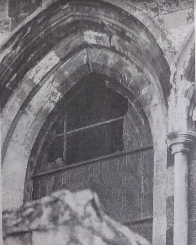 A damaged stained glass window on the west wall of Chichester Cathedral