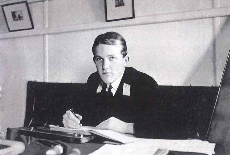Midshipman Hordern in the gunroom, at work on his journal